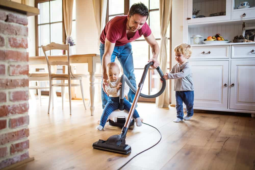 How can vacuuming my house impact the quality of the air in my home?